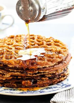 These almond flour waffles are gluten-free AND dairy-free! But more important than that, they're light, crispy, and delicious with maple syrup. Perfect for a big family brunch. #GlutenFree #AlmondFlour #Waffles #Brunch #Breakfast
