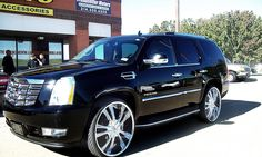 Lexani Wheels, the leader in custom luxury wheels.  2011 Black Cadillac Escalade with chrome lss-55 wheels and ss lip