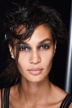 """Francois Nars, Founder and Creative Director of New York Fashion Week's big beauty player described the beauty look at Marc Jacobs as depicting """"the East Village girl who's been out all night"""". Hungover party makeup? Easy. They key is """"too much mascara"""", try NARS Audacious and smudges of blue eye shadow in the inner corners. The hair mirrored the trend with a grungy disheveled chignon.   - Cosmopolitan.co.uk"""