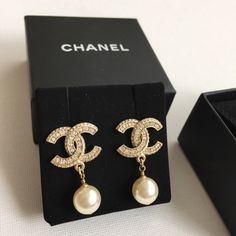 Authentic CHANEL cc stud earrings. Glass pearl and crystal CC logo.   Worn once.  Copy of original receipt available.  Purchased at CHANEL boutique. CHANEL Jewelry Earrings