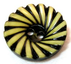 1920'S DEEPLY RECESSED & BUFFED BLACK & IVORY CELLULOID PINWHEEL BUTTON