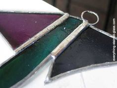 How to add stained glass hooks to a suncatcher. Use recycled wire to make your own hooks and learn how to attach them neatly. Packed with explanatory photos.