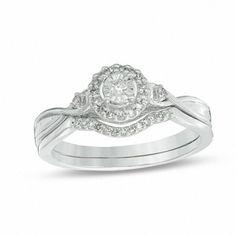 Zales 1/6 CT. T.W. Diamond Frame Twist Shank Bridal Set in Sterling Silver