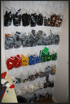 Definately need this for his legos. lol Organizing Legos in an over the door shoe hanger. Great idea - will be setting this up for my daughter. Legos, Shoe Hanger, Scarf Hanger, Scarf Belt, Shoe Rack, Door Shoe Organizer, Lego Room, Lego Storage, Lego Worlds