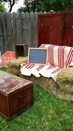 A close up of the photo booth. Loved the Hay bale sofa! Mockingbird Vintage Rentals & Boutique Corpus Christi TX