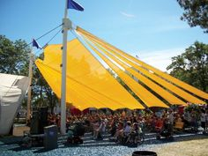 A new tensioned shade structure over the audience area of a family stage at the Minnesota State Fair creates a point of interest for the fairgrounds around which family-friendly vendors and activities can be set up. Photo courtesy of Canvas Craft Inc.