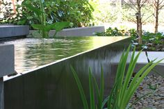 No matter the size of your garden, water features, statuary, and skilled plantings can enhance it, as pictured here in examples by Art in Green.