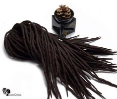 Wool dreadlocks  Chocolate Velvet  DE  Type: Double Ended Material: Worsted wool Method: Felted, handmade Pieces in set: Choose the quantity in the listing options Lenght: 30-40 inch (80-100cm) - 15-20inch (40-50cm) folded in half Thickness: 0.39-0.79 inch (1-2cm) Color: dark brown  Quantity: If you have a mohawk - 30 pieces will be enough If you have a thin hair - 40 pieces will be enough If you have a tchick hair - you need 50-60 pieces   Wool dreadlocks have many advantages:  * Light –…