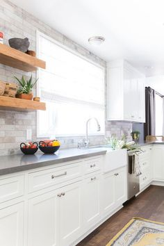 Homepolish-designed kitchen with white cabinets, gray countertops, and textured gray backsplash