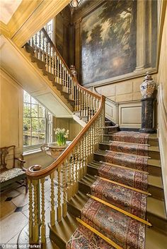 The centrepiece of the mansion is a sweeping staircase surrounded by lavishly painted wall...