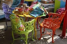 Colorful wrought iron chairs and table.