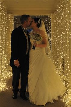 Line the hallway outside your ceremony with curtain lights! Perfect backdrop for photos! #Wedding #WeddingLights