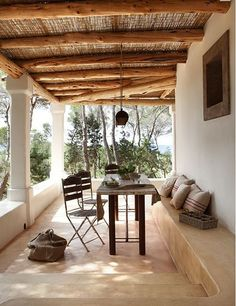 A modern rustic home's covered outdoor porch on Formentera.