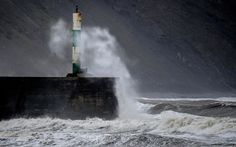 The wind whipped up stormy seas of the Welsh coastal town of Aberystwyth