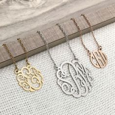 """Show off your monogram with a modern twist with a personalized three-letter monogram necklace. Created in 15mm sterling silver, gold plated over sterling silver, or rose gold plated over sterling silver polished to a high shine, this necklace comes on an 18"""" rope chain with spring ring closure."""