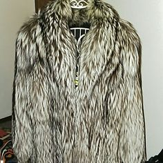 "Genuine silver fox fur stroller coat m Cream of the crop in fox, the silver fox fur stroller size m approx may fit other sizes I'll give you approximate measurements upon request. Serious buyers looking for a serious statement in luxury furs at a 1% of the cost of retail. Once in a lifetime deal, Fur lovers paradise here. Cold stored pelts soft and thick this is not raccoon made to look like the silver fox as allot of those were produced. Please read my "" many furs, about "" listing in my…"
