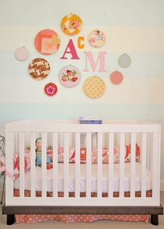 Love the embroidery hoop + monogram above the crib! Eclectic, colorful and fun! #nursery