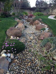Large Dry Creek Bed This on a little bit smaller scale would be perfect between yards, or down the middle of a garden for a large backyard. Large Backyard Landscaping, Landscaping With Rocks, Landscaping Tips, Acreage Landscaping, Inexpensive Landscaping, Mailbox Landscaping, Sloped Backyard, Country Landscaping, Backyard Ideas