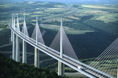 The Millau Viaduct in France is the tallest bridge on the Globe at 343 meters high. Built upon the designs of master architect Norman Foster, this cable suspension bridge is a combination of concrete and steel. It crosses the valley of River Tarn. Love Bridge, High Bridge, Sky Bridge, Norman Foster, Scary Bridges, Saint Michael, Ville France, Voyage Europe, Manchester City