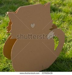 Creative decorations of cardboard  in park. Cat