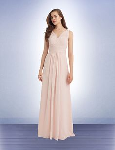 96a326f16e5 Chiffon sleeveless gown with a sheer illusion top and V-back. Vertical  pleats accent the bodice. Pleated cummerbund adorns the waist.