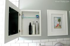 When your bathroom mirror doesn't double as a medicine cabinet, try these cool hidden shelves that display art when closed.
