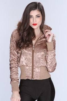 With winter on its way this jacket will perfect for this season! Youll be stylish and warm at the same time! Youll love it the moment you try it on! This must have jacket features removable hoodie with faux fur trim, stitch detailing, rhinestone design, long sleeves, front zipper closure, and fitted. 100% Polyester.