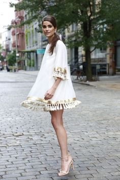 A white cocktail dress with tassels? Yes please. It's a favorite and for good reason. Comfortable, chic and glamorous. #whiteandgold