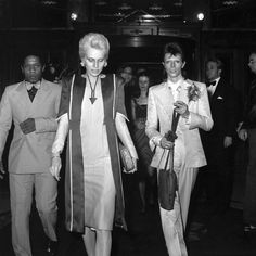 """David Bowie (right) and his wife Angie arriving at London's Cafe Royal for Bowie's legendary """"Last Supper"""" party to say farewell to 'Ziggy Stardust and the Spiders From Mars' who gave their last ever show the night before."""