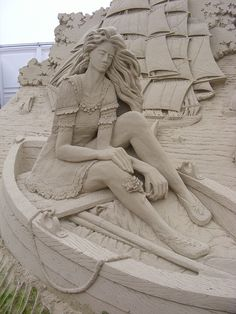 Sand sculpture of a woman in a rowboat
