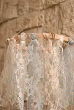 Create lace fabric chandeliers. These chandeliers are dainty and pretty. They go well as decors for rustic and shabby chic themed wedding.