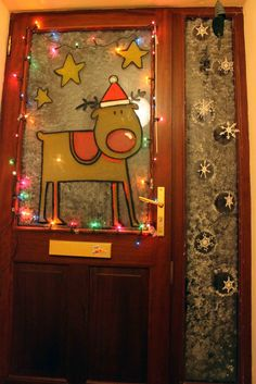 "Paint Your Front Door Window for Christmas (or any Holiday); Decoration Idea - Rudolph with a Santa Hat & Stars: I think you can buy ""window markers"" that would probably work for this. Use lights around the edge of the window to light up the design from the inside for at night. (Battery operated lights?)"