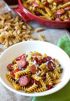 This hearty pasta recipe with sausage and peppers will be a new family favorite. Savory sausage and sweet red peppers are a winning combination! Recipes With Sausage And Peppers, Sausage And Peppers Pasta, Sausage Recipes, Pork Recipes, Pasta Recipes, Cooking Recipes, Tasty Dishes, Food Dishes, Main Dishes