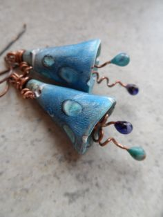 Flower Whimsy ... Polymer Clay, Lampwork and Copper Wire-Wrapped Whimsical, Boho Earrings by juliethelen on Etsy https://www.etsy.com/listing/222411842/flower-whimsy-polymer-clay-lampwork-and
