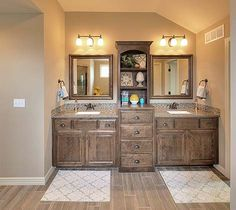 Double Vanity Bathroom Rugs adding a cabinet on top of a long counter between sinks in the