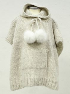 Hood Poncho. This MUST be doable for grownups too.. :)  Love the pom poms by the way
