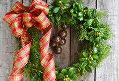 Gather pine and holly to create your own evergreen wreath. Embellish with a bold plaid bow and jingle bells for a merry greeting at your front door. See more wreaths at the Garden Club.