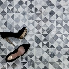 """Classic Carrara and Bardiglio marble in the extremely versatile triangular pattern. Shop this tile pattern and more at TileBar.com. Krista Watterworth """"Kiss"""" pictured above."""