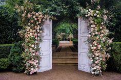Beautiful backdrop using doors & gorgeous florals