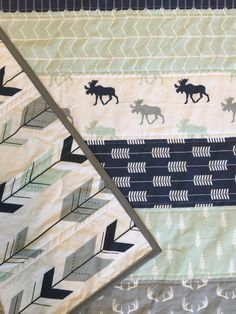 Our Woodland quilt would be a great addition to any Modern baby nursery/room. With a combination for modern colors and prints including