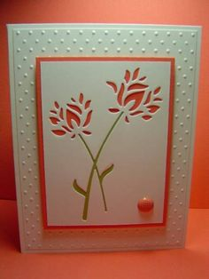 """By crazysuziestamper at Splitcoaststampers. Die cut flowers from white cardstock panel using Memory Box """"Wild Blooms"""" die. Adhere green cardstock (Pear Pizzaz here) in back of stems. Mount onto a solid color panel (Calypso Coral here). Pop up over dry embossed white panel layered on white cardstock base. Add brad or other bling."""