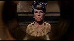 Rosemary's Baby: The Dakota, the brownstone where the action takes place, is said to be haunted in real life. Some feel Mia Farrow's haircut is the most frightening reveal, but not so. Her neighbor Minnie Castevet (Ruth Gordon) makes us beware neighbors in curlers bearing mousse.