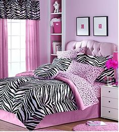 Bedding idea.  Like the mix of cheetah sheets and zebra comforter.  I personally would stick with white curtains