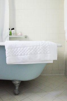 Blue clawfoot bathtub
