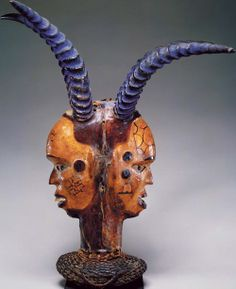 Janus-Faced Headdress, 19th–20th century  Nigeria, Cross River region; Ejagham, Akparabong clan Wood, leather, paint, cane, horn, nails; H. ...