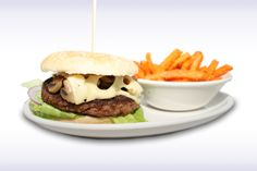 Mushroom Swiss - Gourmet Burger topped with sliced Mushroom and Swiss Cheese. Served with a crisp Lettuce Leaf with sliced Tomato, Onion and Chips.