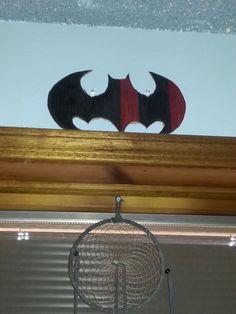 Cardboard batman symbol. Made by Laura A. Harley Quinn colors.