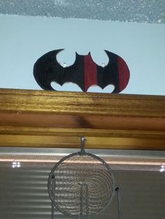 Cardboard batman symbol. Made by Laura A. Harley Quinn colors.