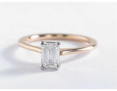 Elegant in its simplicity, this petite solitaire engagement ring crafted in 14k rose gold is a beautiful frame for this emerald cut diamond.