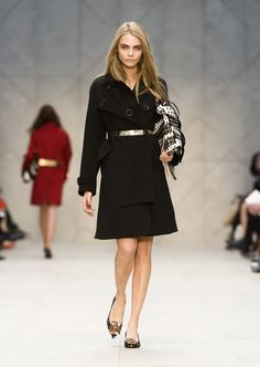 Cara Delevingne wearing regimental greatcoat and the Big Crush bag on the Burberry A/W13 Womenswear runway